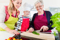 Granny showing old family recipe to grandson and daughter Royalty Free Stock Photo