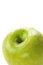 Granny smith apple closeup of a with dew drops on a white background Royalty Free Stock Photography