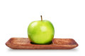 Granny smith apple green on wooden plate Royalty Free Stock Photo