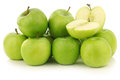 Granny smith apples freshly harvested and a cut one on a white background Stock Photos