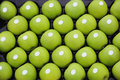 Granny smith apples green in crate Stock Photos