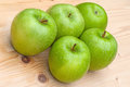Granny smith green apples on wooden table Royalty Free Stock Photos