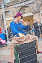 Granny turismo in street theatre one of three grannies on a shopping trolley playing a part inverness held between th and th Royalty Free Stock Photography