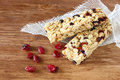 Granola bar or energy bar on wooden background Royalty Free Stock Photo