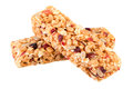 Granola bars isolated on white. Granola ingredients oats, dried cranberries, nuts, sunflower seeds, honey Royalty Free Stock Photo