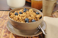 Granola with fresh blueberries and a pitcher of milk Royalty Free Stock Photos