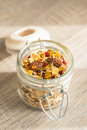 Granola with goji berries, almond nuts, peanuts, oat flakes, honey in jar Royalty Free Stock Photo