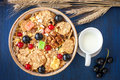 Granola muesli with red and black currants and milk in a jug berries bowl Royalty Free Stock Image