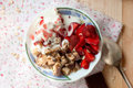 Granola with strawberries yogurt and strawberry topping milk j oatmeal jug for breakfast toned image selective focus Stock Photography