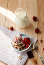Granola with strawberries yogurt and strawberry topping milk j oatmeal jug for breakfast toned image selective focus Stock Photos