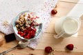 Granola with strawberries yogurt and strawberry topping milk j oatmeal jug for breakfast toned image selective focus Royalty Free Stock Photo