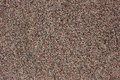Granular wall surface texture background with small colored stones Stock Images