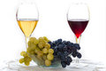 Grape with red and white wine isolated on background Royalty Free Stock Photo