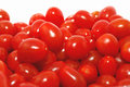 Grape tomatoes closeup isolated on the white. Royalty Free Stock Photo