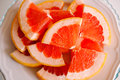 Grapefruit cut pieces of fresh and juicy for healthy breakfast or snack Royalty Free Stock Photos