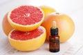 Grapefruit essential oil bottle of beauty treatment Stock Photos