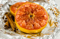 Grapefruit half baked with drizzled honey and cinammon Royalty Free Stock Images