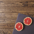 Grapefruit halves on a wooden background Royalty Free Stock Image