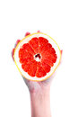 Grapefruit in hand on a white background Royalty Free Stock Photo