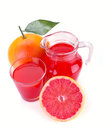Grapefruit juice and fruit in a jug a glass of Stock Photos