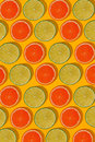 Grapefruit and lime pattern on yellow background. Minimal flat lay concept.