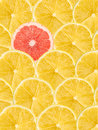 Grapefruit Slice Stand Out From Crowd Royalty Free Stock Photo