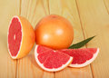 Grapefruit slices on background of wooden table a a Royalty Free Stock Images