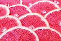 Grapefruit slices fresh and background Stock Photos