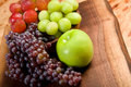 Grapes and Apple Stock Images