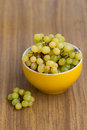 Grapes in bowl over wooden background Royalty Free Stock Image