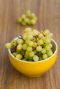 Grapes in bowl over wooden background Stock Photo
