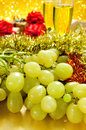 Grapes, champagne and gifts Royalty Free Stock Photo