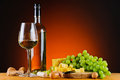 Grapes cheese and wine still life with glass bottle of white Stock Photo