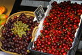 Grapes and cherries baskets of Royalty Free Stock Photo