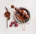 Grapes in chocolate making top view on white wooden background Stock Photography