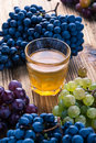 Grapes and freshly squeezed grape juice fresh on rustic wooden table harvest time Stock Photos