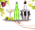 Grapes ice bucket with champagne on a tray butterfly bottle of and glass silver isolated white baclground Stock Photography