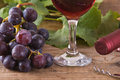 Grapes image of a bunch of on wooden table Royalty Free Stock Photos