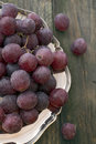 Grapes metal tray with on a wooden table Royalty Free Stock Photo