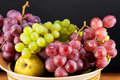 Grapes and pears in a bowl ripe Stock Photography