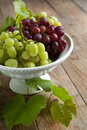 Grapes in vase on a wooden table fresh Royalty Free Stock Image
