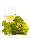 Grapes white with a glass of white wine isolated on white background Royalty Free Stock Photo