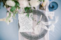 Graphic arts of beautiful wedding calligraphy cards and silver plate with cutlery. Royalty Free Stock Photo