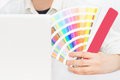 Graphic designer at work close up of holding pantone palette Stock Image