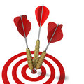 Graphic hitting the mark dart right on target three darts center Royalty Free Stock Photos