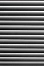 Graphic texture in black and white abstract striped pattern. Blinds on the window with the dust on the light strips Royalty Free Stock Photo
