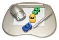 Graphics tablet a computer with stylus pen wireless mouse and colourful toy cars isolated on a white background Stock Photos