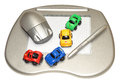 Graphics tablet a computer with stylus pen wireless mouse and colourful toy cars isolated on a white background Royalty Free Stock Photos