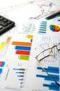 Graphs and charts on worktable with pen glasses Royalty Free Stock Photo