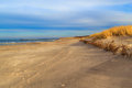 Grass covered dunes shores baltic sea on the of the Royalty Free Stock Photos